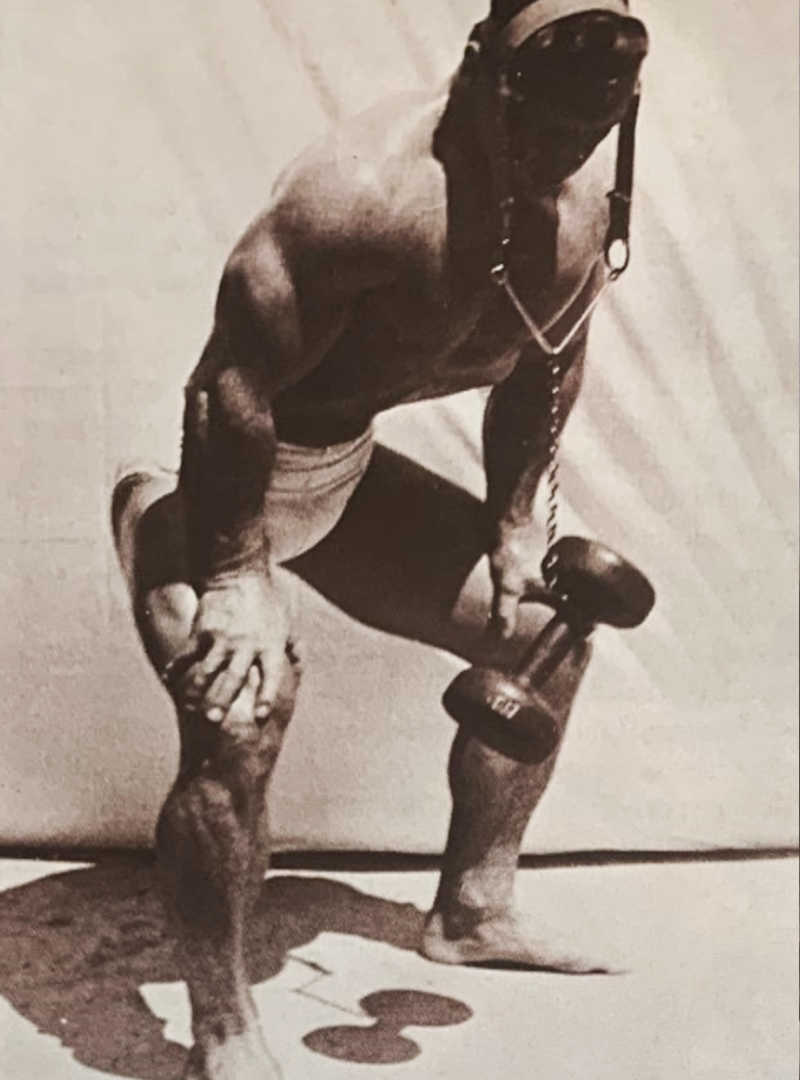 John Grimek performing Standing Bent Knee Neck Extension