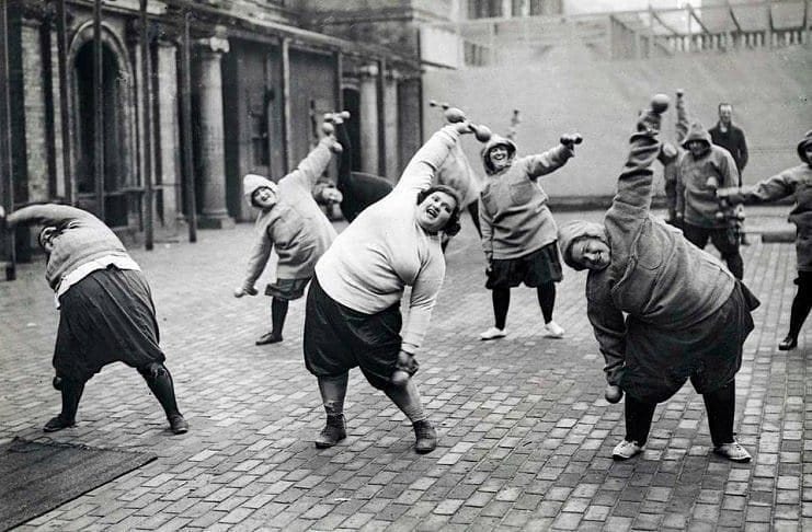 Women undergoing a slimming course in a courtyard in New York