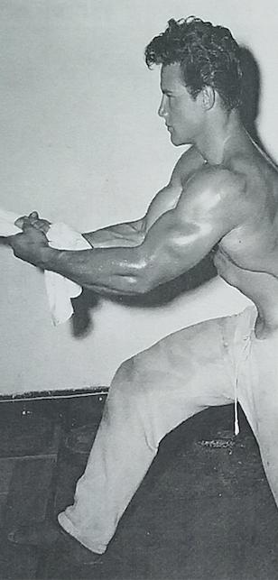 Steve Reeves Stretching Between Sets