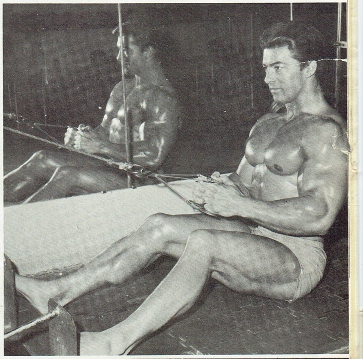 Larry Scott performing Long Floor Pulley Pulls