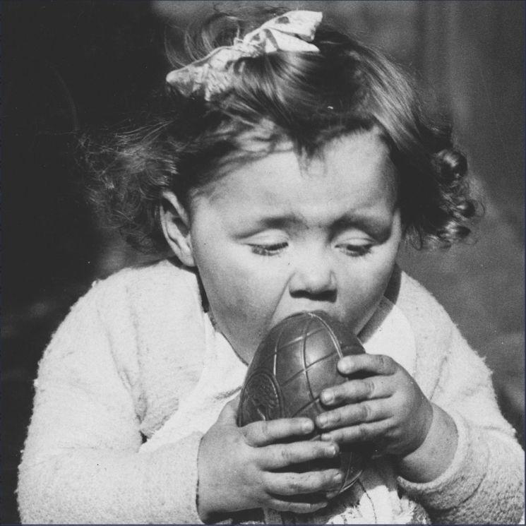 Girl eating Easter Egg Chocolate