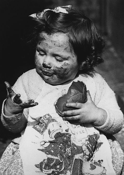 Girl making a Mess eating Easter Egg Chocolate