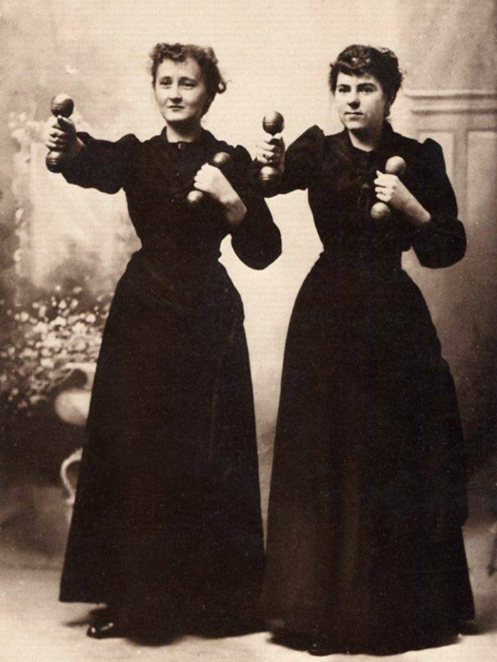 Photograph of Two Cheerful Ladies Working Out in Street Clothes Posing Photography by Willis T White