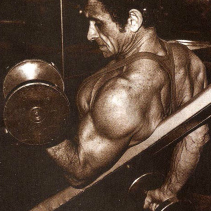 Vince Gironda Performing an Incline Biceps Curl