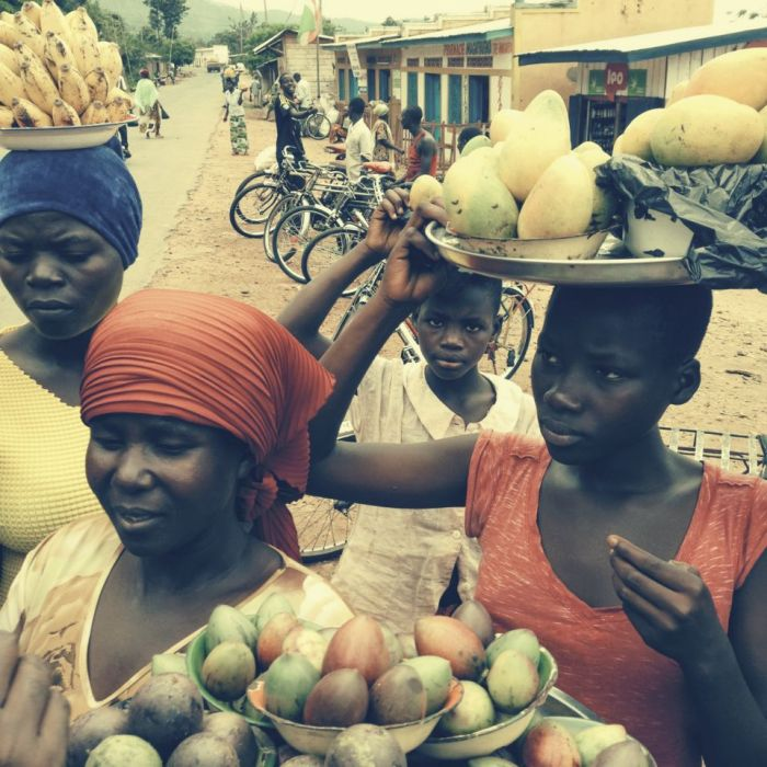 Burundian women carrying fruit.