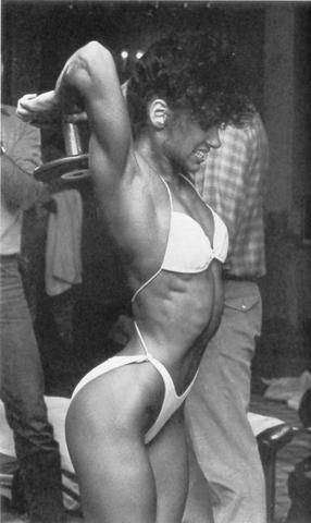 Gladys Portugues performing Behind the Neck Curl